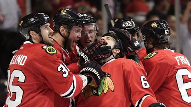 Chicago Blackhawks center Andrew Shaw (C) celebrates his game-winning triple overtime goal against the Boston Bruins with teammates Dave Bolland (36), Brandon Saad (20) and Jonathan Toews (19) during Game 1 of their NHL Stanley Cup Finals series (Reuters)