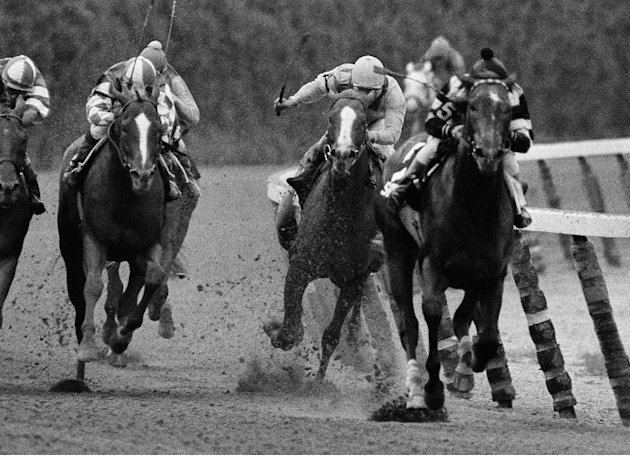 FILE - In this June 9, 1979, file photo, Coastal, second from right, ridden by Ruben Hernandez, makes the move to pass Spectacular Bid (5), with Ronnie Franklin, on the final turn during the Belmont S