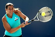 Marion Bartoli of France returns a shot to Mallory Burdette during the Bank of the West Classic at Stanford University Taube Family Tennis Stadium, on July 12, in Stanford, California. Bartoli won 7-5, 6-0
