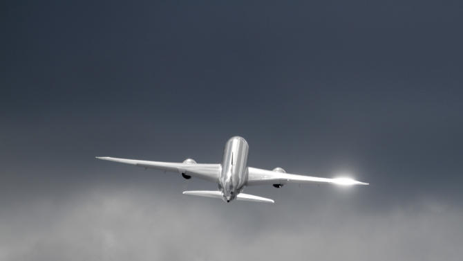 A Qatar Airways Boeing 787 Dreamliner flies during a display on the third day of the Farnborough International Airshow, in Farnborough, England, Wednesday, July 11, 2012. (AP Photo/Lefteris Pitarakis)