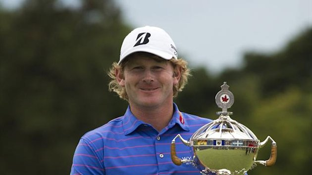 Brandt Snedeker holds the trophy after winning during the final round at the Canadian Open golf tournament at the Glen Abbey Golf Club (Reuters)