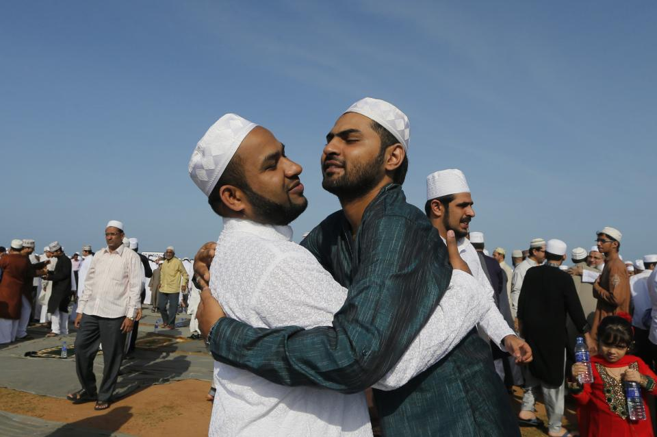 Sri Lankan Muslims hug each other after a prayer session to mark the Eid al-Fitr in Colombo, Sri Lanka, Sunday, Aug. 19, 2012. Eid al-Fitr marks the end of the holy month of Ramadan. (AP Photo/Eranga Jayawardena)