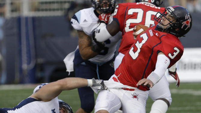 Maine holds off Richmond's late rally to win 28-21