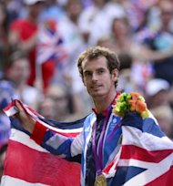 &lt;p&gt;Great Britain&#39;s Andy Murray poses with his gold medal at the end of the men&#39;s singles tennis tournament of the London 2012 Olympic Games, at the All England Tennis Club in Wimbledon, southwest London,&lt;/p&gt;