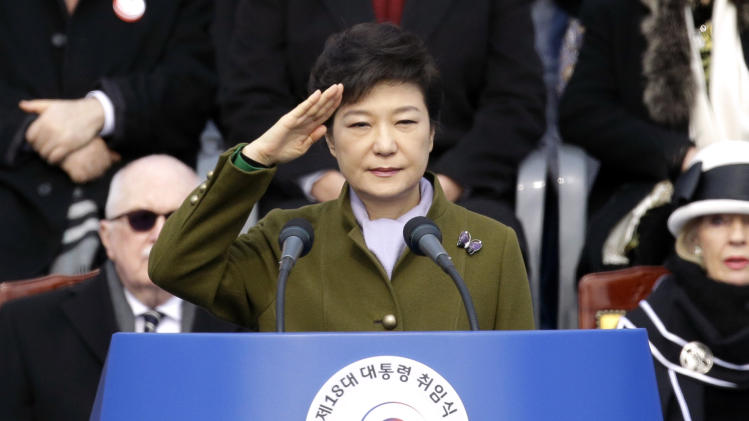 South Korea's new President Park Geun-hye salutes during her inauguration ceremony as the 18th South Korean president, at the National Assembly in Seoul, South Korea, Monday, Feb. 25, 2013. Park took office as South Korea's first female president Monday, returning to the presidential mansion she had known as the daughter of a dictator, and where she will respond to volatile North Korea, which tested a nuclear device two weeks ago. (AP Photo/Lee Jin-man)