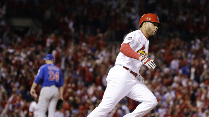 St. Louis Cardinals' Tommy Pham runs after hitting a solo home run off Chicago Cubs starting pitcher Jon Lester (34) during the eighth inning of Game 1 in baseball's National League Division Series Friday, Oct. 9, 2015, in St. Louis. (AP Photo/Jeff Roberson)