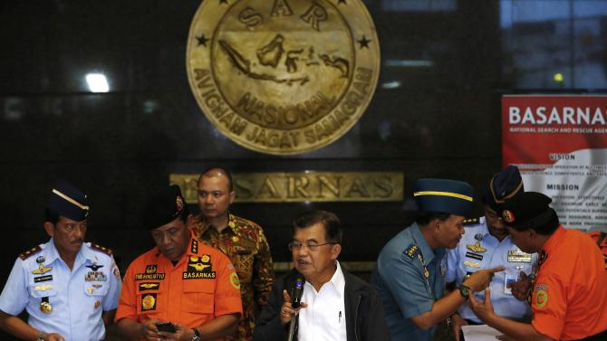 Indonesia's vice-president Kalla speaks to the media regarding AirAsia Flight QZ8501 during a visit to the National Search and Rescue Agency in Jakarta
