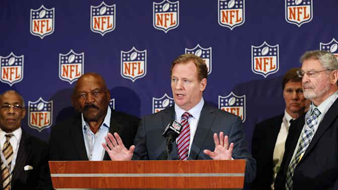 NFL football commissioner Roger Goodell, center, speaks during a news conference at the Arizona Biltmore, Monday, March 18, 2013, in Phoenix. They announced the NFL has agreed to pay $42 million as part of a settlement with a group of retired players who challenged the league over using their names and images without their consent. (AP Photo/Matt York)