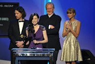 From left, John Paul White, Joy Williams, T Bone Burnett and Taylor Swift accept the award for song written for visual media for &quot;Safe and Sound&quot; (From The Hunger Games) at the 55th annual Grammy Awards on Sunday, Feb. 10, 2013, in Los Angeles. (Photo by John Shearer/Invision/AP)