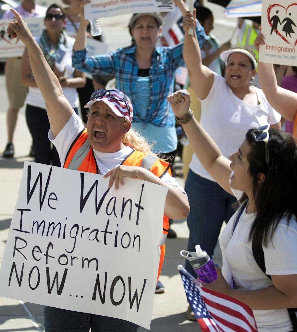 Martina Cano joins others in a May Day march for immigration reform from the Children's Museum to Calder Plaza in Grand Rapids, Mich. on Wednesday, May 1, 2013. (AP Photo/MLive.com, Latara Appleby)