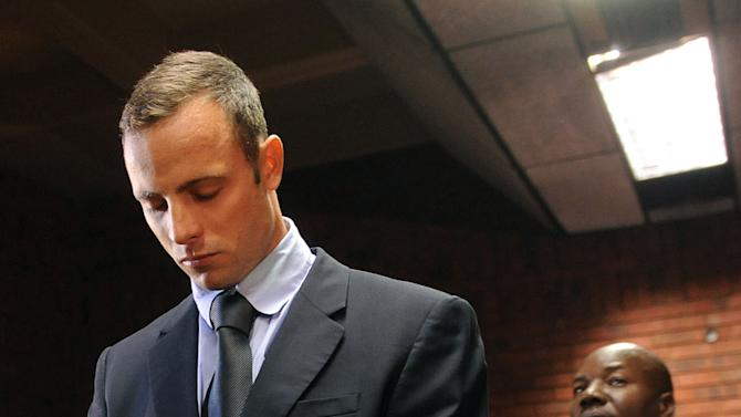 Olympic athlete, Oscar Pistorius , in court Friday Feb. 22, 2013 in Pretoria, South Africa, for his bail hearing charged with the shooting death of his girlfriend, Reeva Steenkamp. The defense and prosecution both completed their arguments with the magistrate soon to rule if the double-amputee athlete can be freed before trial or if he must stay behind bars pending trial. (AP Photo)