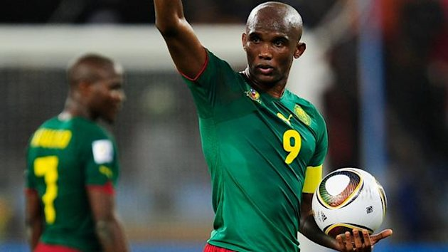 Samuel Eto'o of Cameroon is dejected after defeat and elimination from the tournament in the 2010 FIFA World Cup South Africa Group E match between Cameroon and Netherlands at Green Point Stadium on June 24, 2010