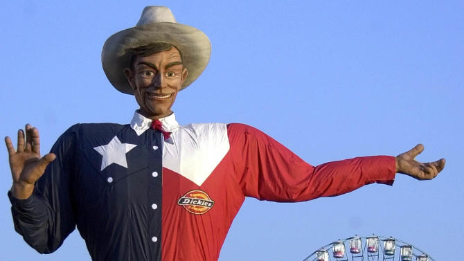 FILE - In this Sept. 27, 2002 file photo, Big Tex welcomes visitors to the Texas State Fair in Dallas. Fire destroyed Big Tex on Friday, Oct. 19, leaving behind little more than the metal frame of the 52-foot-tall metal-and-fabric cowboy that is an icon of the State Fair of Texas.  (AP Photo/LM Otero, File)