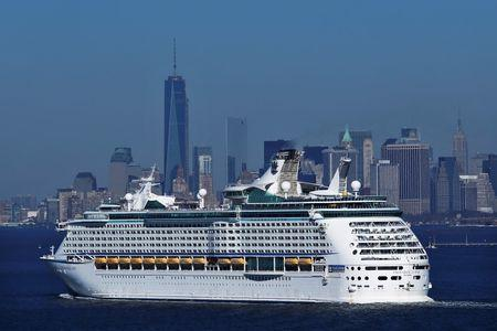 New York skyline is seen in a distance as Royal Caribbean's Explorer of the Seas enters New York harbour