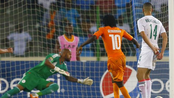 Ivory Coast's Kouassi Gervais scores a goal against Algeria in their quarter-final soccer match of the 2015 African Cup of Nations in Malabo