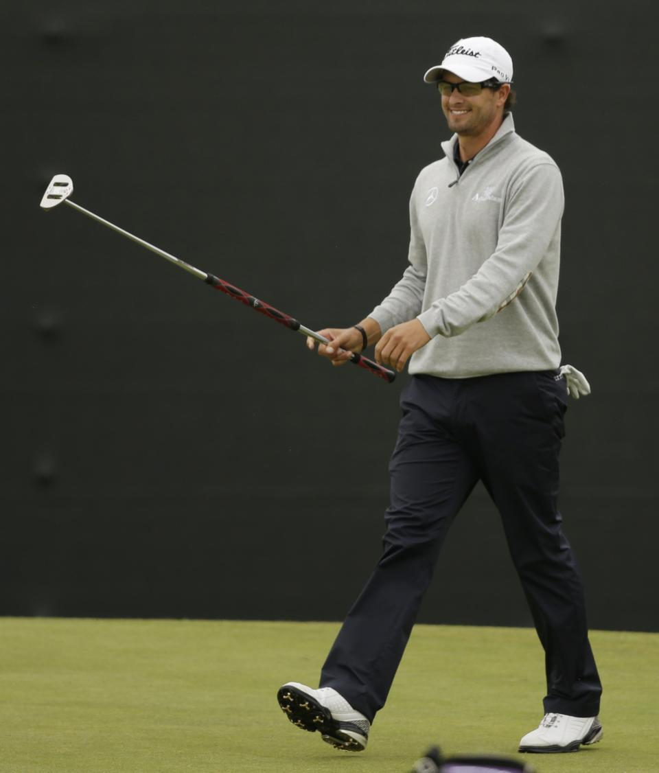 Adam Scott of Australia reacts after a birdie on the 12th green at Royal Lytham & St Annes golf club during the second round of the British Open Golf Championship, Lytham St Annes, England, Friday, July 20, 2012. (AP Photo/Tim Hales)