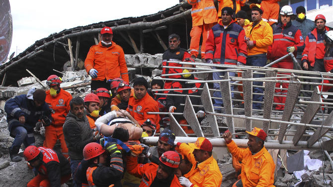 Rescue workers pull out a man from the rubble of a collapsed hotel in Van, eastern Turkey, early Thursday, Nov. 10, 2011. Rescuers have pulled out 24 survivors from the rubble of three buildings, collapsed by an earthquake in Van, the country's disaster management authority said Thursday. At least seven were killed and dozens of others trapped. The magnitude-5.7 quake was a grim replay of the previous magnitude-7.2 earthquake that hit Oct. 23, killing more than 600 people. (AP Photo )