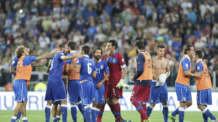 Italy players celebrate after winning the 2014 World Cup Group B qualifying soccer match between Italy and Czech Republic at the Juventus stadium in Turin, Italy, Tuesday, Sept. 10, 2013. Italy secured qualification for the 2014 World Cup with two matches to spare on Tuesday after coming from behind to beat the Czech Republic 2-1. (AP Photo/Antonio Calanni)