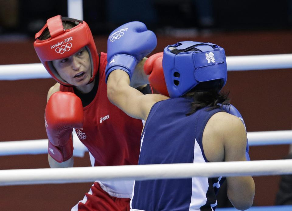 Ireland's Katie Taylor, left, fights Tajikistan's Mavzuna Chorieva in a lightweight 60-kg semifinal boxing match at the 2012 Summer Olympics, Wednesday, Aug. 8, 2012, in London. (AP Photo/Patrick Semansky)