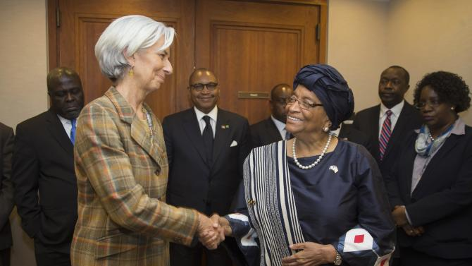 IMF Managing Director Lagarde shakes hands with Liberian President Sirleaf after their meeting at the IMF Headquarters in Washington