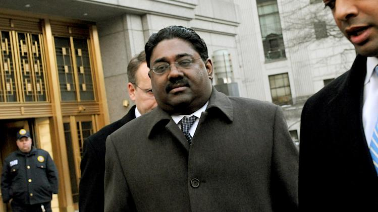 FILE - In this file photo taken Feb. 17, 2010, Raj Rajaratnam, left, billionaire founder of the Galleon Group, a major hedge fund, leaves Manhattan federal court in New York.  (AP Photo/Louis Lanzano, File)