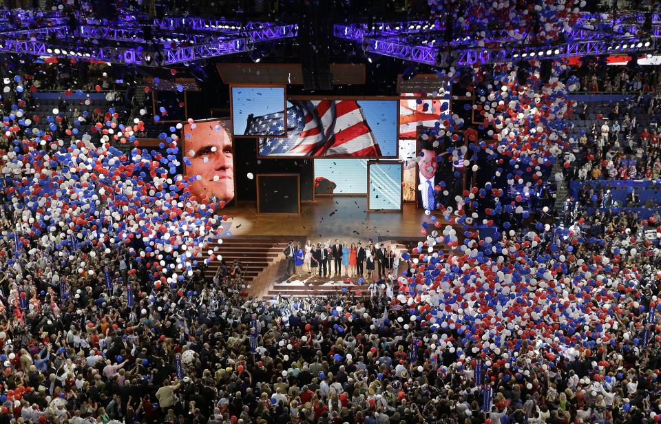 Republican presidential nominee Mitt Romney and vice presidential nominee Rep. Paul Ryan are join on the stage by their families at the end of the Republican National Convention in Tampa, Fla., on Thursday, Aug. 30, 2012. (AP Photo/Patrick Semansky)