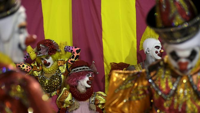 Revellers of the Sao Clemente samba school wait to participate during the carnival parade at the Sambadrome in Rio de Janeiro