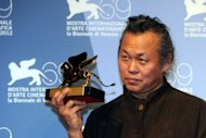 "South Korean film director Kim Ki-Duk, seen here with the Golden Lion for best movie during a photocall following the awards ceremony of the 69th Venice Film Festival at Venice Lido. The phenomenal success of the song ""Gangnam Style"" is just the start of a new surge of attention for Korean entertainment, according to the man responsible for some of South Korea's biggest films"