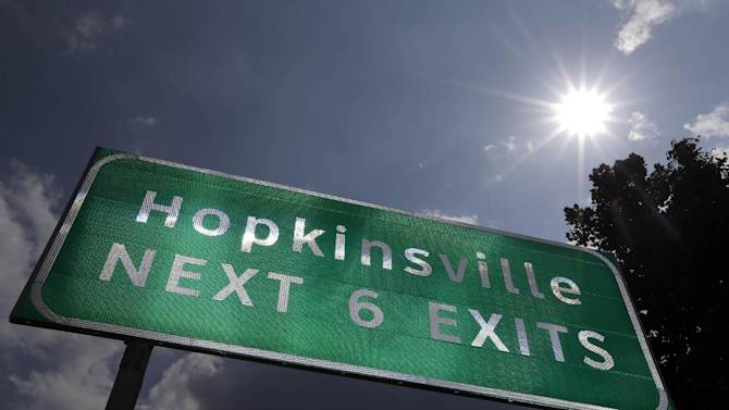 This Aug. 27, 2012 photo shows a road sign under the afternoon sun outside Hopkinsville, Ky. When the next total eclipse of the sun darkens skies over parts of the United States on Aug. 21, 2017, the afternoon event will last longer in a rural stretch near Hopkinsville than any place on the planet. (AP Photo/Mark Humphrey)
