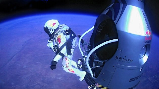Oct. 14, 2012 file image provided by Red Bull Stratos shows pilot Felix Baumgartner of Austria as he jumps out of the capsule during the final manned flight for Red Bull Stratos. In a giant leap from
