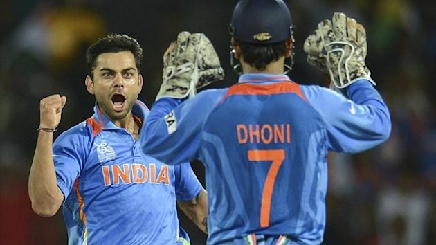 India's Virat Kohli and MS Dhoni celebrate at the World T20 (Reuters)