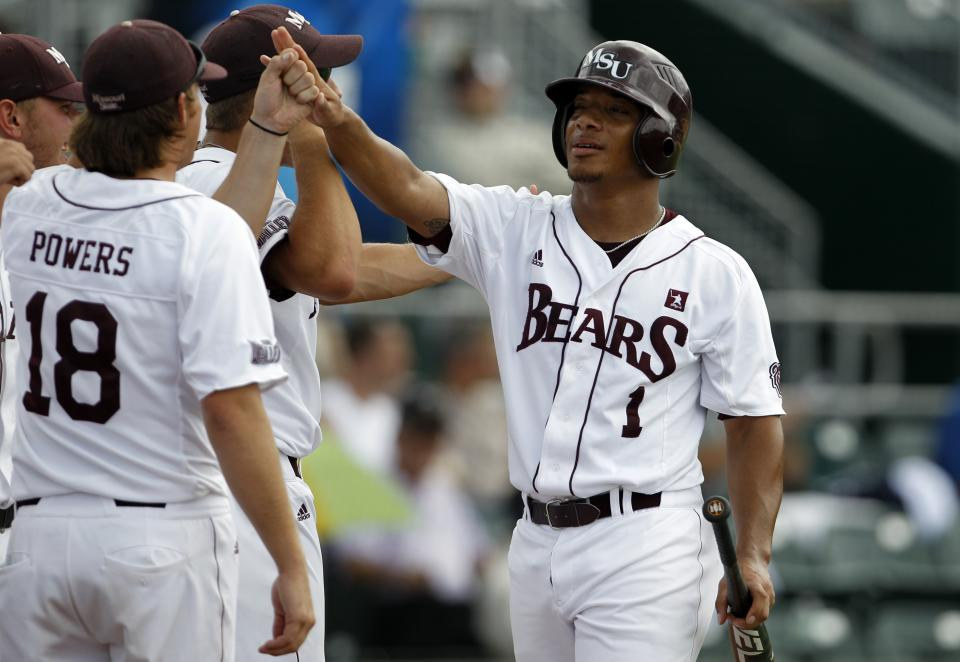 Missouri State's Keenen Maddox (1) is met by Jake Powers (18) after scoring on a single by Derek Mattea in the first inning of an NCAA college baseball tournament regional game against Miami, Saturday, June 2, 2012, in Coral Gables, Fla. (AP Photo/Lynne Sladky)