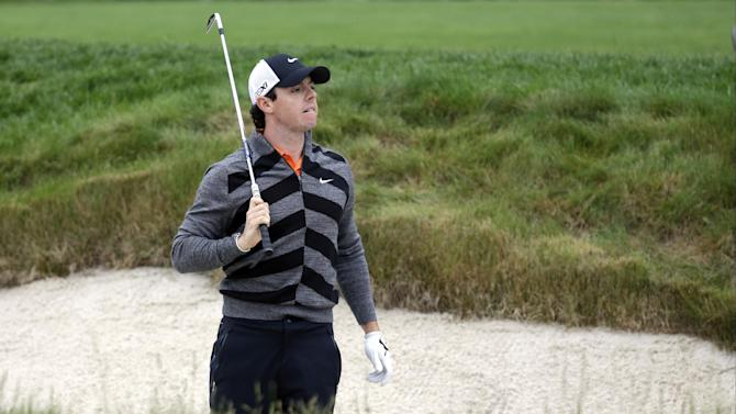 Rory McIlroy, of Northern Ireland, checks his shot out of a bunker on the 15th hole during the first round of the U.S. Open golf tournament at Merion Golf Club, Friday, June 14, 2013, in Ardmore, Pa. (AP Photo/Morry Gash)