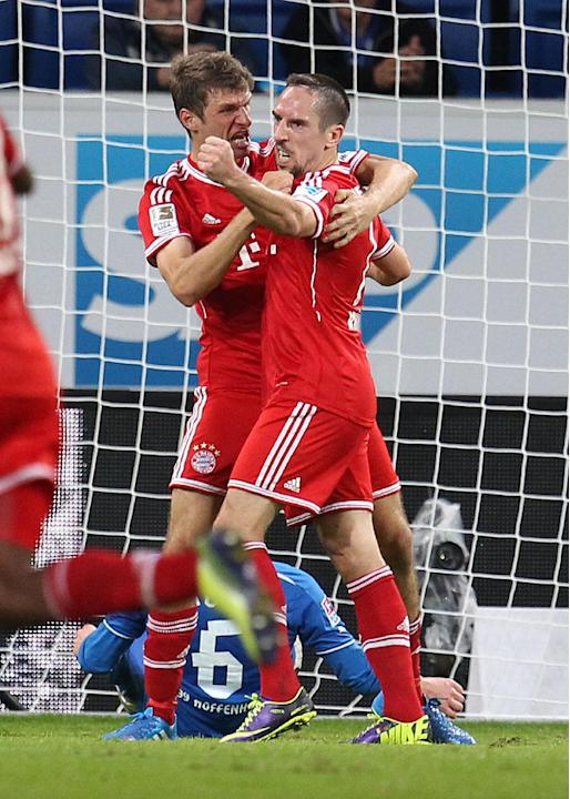 Bayern's Thomas Mueller, left, and Bayern's Franck Ribery of France celebrate Mueller's leading goal during a German first division Bundesliga soccer match between TSG 1899 Hoffenheim and Bayern Munic