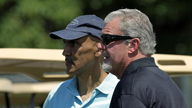 Indianapolis Colts owner Jim Irsay, right, and former head coach Tony Dungy watch the first day of practice at the NFL team's football training camp in Anderson, Ind., Sunday, July 29, 2012. (AP Photo/Michael Conroy)