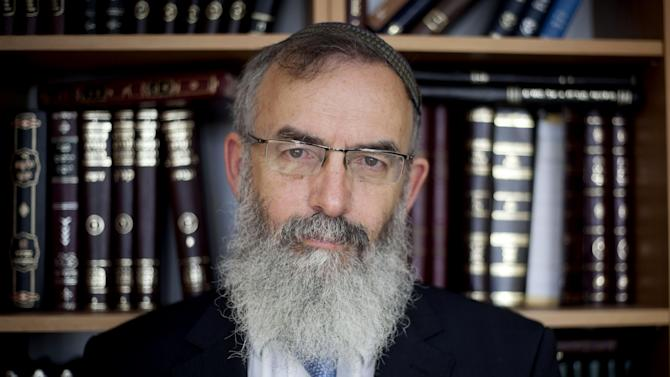 Modern Orthodox Rabbi David Stav poses for a photograph at his office in Soham, central Israel, Wednesday, Feb. 13, 2013. When Rabbi David Stav launched his official campaign last month to wrest control of Israel's top religious institution from its longtime hardline leadership, it was a long shot. But just two weeks later, Israelis went to the polls and surprisingly shifted the country toward the center of the political spectrum — creating a rare window of opportunity for the modern Orthodox rabbi to capture the title of chief rabbi and fulfill his pledge to revolutionize the contentious role that religion plays in the Jewish state. (AP Photo/Ariel Schalit)