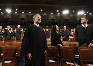 U.S. Supreme Court Chief Justice John Roberts arrives prior to President Barack Obama's State of the Union speech on Capitol Hill in Washington