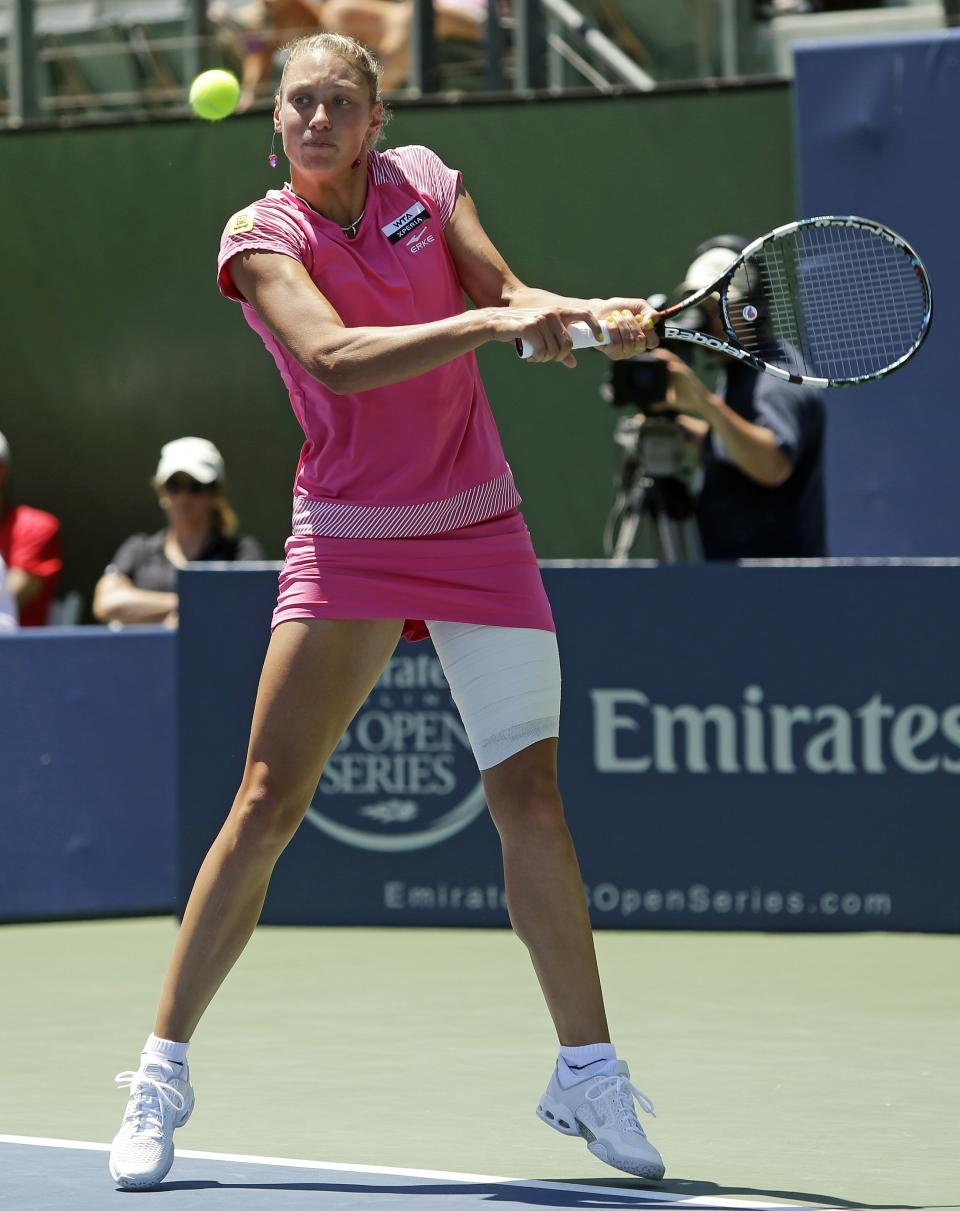 Yanina Wickmayer, of Belgium, returns to Coco Vandeweghe, of the United States, during a semifinal of the Bank of the West tennis tournament Saturday, July 14, 2012, in Stanford, Calif. (AP Photo/Marcio Jose Sanchez)
