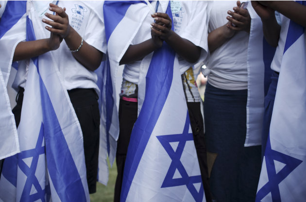 Ethiopian Israeli Jews sing before an agricultural parade celebrating Jerusalem, in downtown Jerusalem, Monday, May 30, 2011. (AP Photo/Tara Todras-Whitehill)