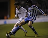 Real Madrid&#39;s midfielder Kaka (L) clashes with Deportivo&#39;s midfielder Abel Aguilar during the Spanish league football match at Riazor stadium in Coruna on February 23, 2013. Real Madrid had to come from behind as second-half goals from Kaka and Gonzalo Higuain handed them a hard-fought 2-1 at relegation threatened Deportivo La Coruna