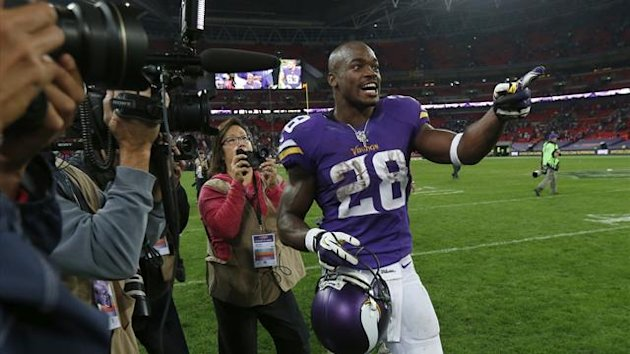 Vikings running back Adrian Peterson celebrates after his side defeated the Steelers during their NFL match at Wembley Stadium (Reuters)