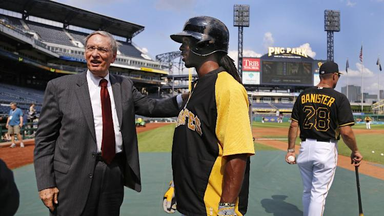 Commissioner of Major League Baseball, Bud Selig, left, visits with Pittsburgh Pirates center fielder Andrew McCutchen, center, during batting practice at PNC Park before a baseball game between the Pittsburgh Pirates and the Los Angeles Dodgers in Pittsburgh Tuesday, July 22, 2014. (AP Photo)
