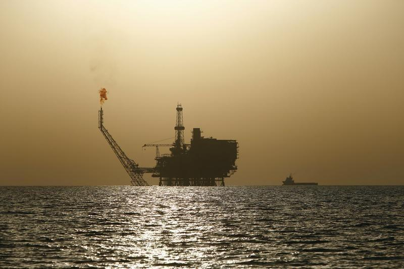 Oil choppy on profit-taking in biggest weekly surge since 2009