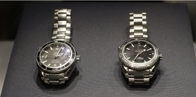 Two Omega watches, left, a Seamaster Planet Ocean model used by Daniel Craig in the James Bond movie 'Quantum of Solace', and a Seamaster Planet Ocean model which is made of Titanium and used by Craig