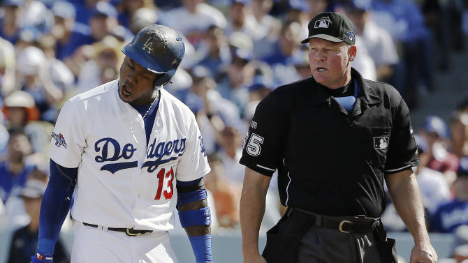 Los Angeles Dodgers' Hanley Ramirez argues a strike three call by home plate umpire Ted Barrett during the first inning of Game 5 of the National League baseball championship series against the St. Louis Cardinals Wednesday, Oct. 16, 2013, in Los Angeles. (AP Photo/David J. Phillip)