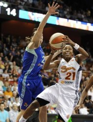Connecticut Sun's Renee Montgomery, right, drives to the basket while guarded by New York Liberty's Kelly Miller in the first half of a WNBA basketball game in Uncasville, Conn., Friday, June 15, 2012. (AP Photo/Jessica Hill)
