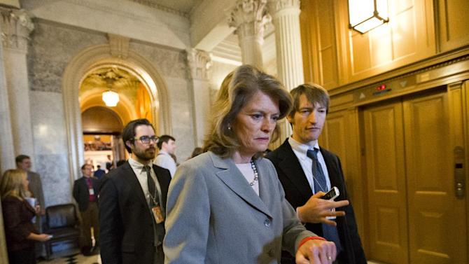 Sen. Lisa Murkowski, R-Alaska, leaves the Senate chamber as Senate Republicans stalled the nomination of former GOP senator Chuck Hagel as the nation's next defense secretary, at the Capitol in Washington, Thursday, Feb. 14, 2013. Murkowski was one of four Republicans who voted with Democrats to end the debate and proceed to a final vote.  (AP Photo/J. Scott Applewhite)