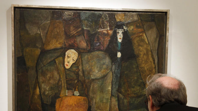 "A visitor look at the painting titled ""Procession"" from Egon Schiele dates back to 1911 and depicts three women in different stages of their lives, in Vienna, Austria, on Wednesday, Nov. 3, 2010. Austrian auctioneers have unveiled a precious Egon Schiele painting that could fetch millions when it goes under the hammer next week. Currently owned by an unidentified American art collector, it is valued at 3.5 million euros to 7 million euros. The auction takes place Tuesday. (AP Photo/Ronald Zak)"