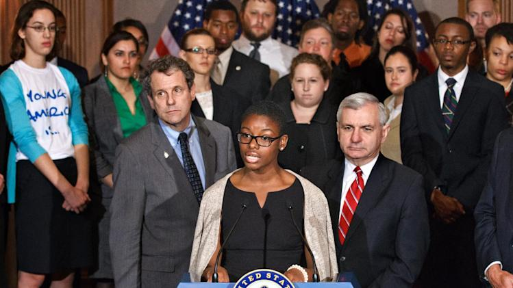 Clarise McCants of Philadelphia, a Howard University political science major, center, flanked by Sen. Sherrod Brown, D-Ohio, left, and Sen. Jack Reed, D-R.I., right, and accompanied by students, speaks during a news conference on Capitol Hill in Washington, Tuesday, May 8, 2012, as the Senate moves toward a showdown on a Democratic proposal to keep federally subsidized loan interest rates from doubling for millions of college students. (AP Photo/J. Scott Applewhite)
