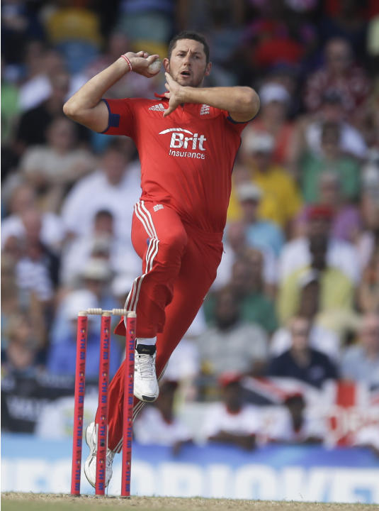 England's Tim Bresnan bowls during the first T20 International cricket match against West Indies at the Kensington Oval in Bridgetown, Barbados, Sunday, March 9, 2014. (AP Photo/Ricardo Mazalan)